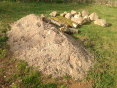 Sand, Holz und Steine